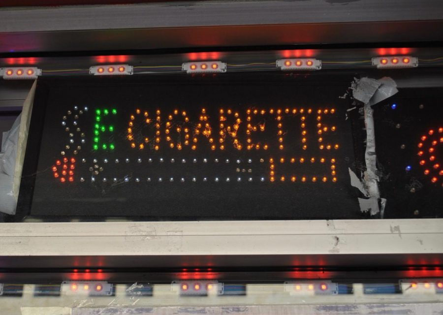 A lighted sign advertises E Cigarettes.