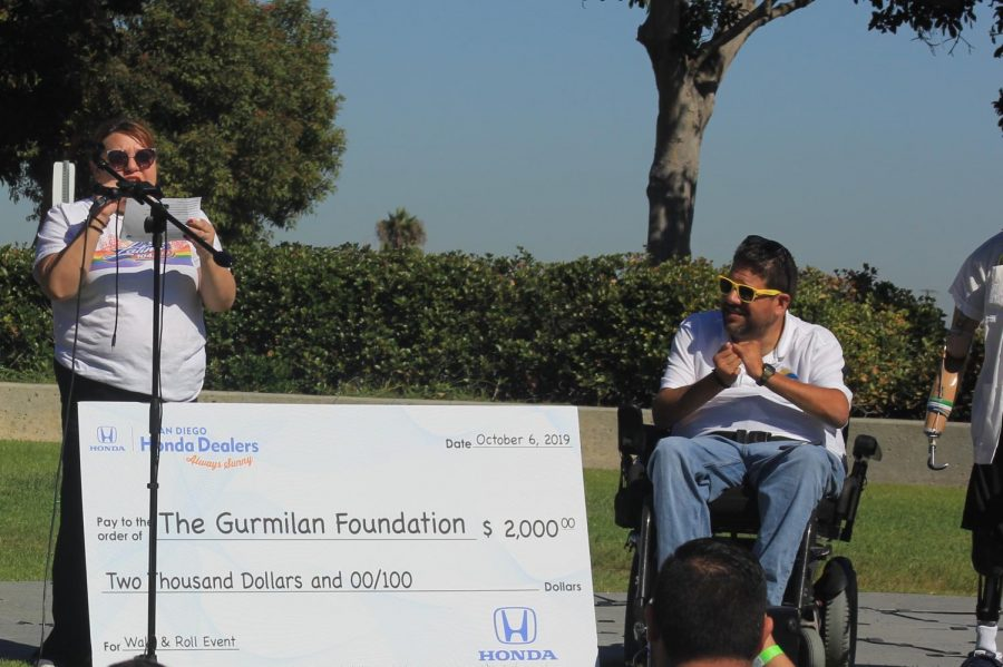 Humberto Gurmilan accepts a donation on behalf of his foundation. Photo by Sonny Garibay