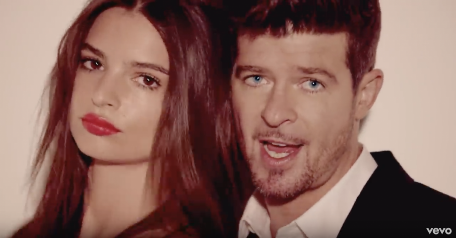 Robin Thicke singing Blurred Lines in the music video.