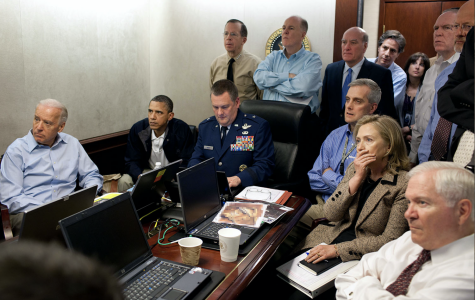 President Obama and Vice president Biden alongside members of the national security team receive an update of the mission against Osama bin Laden.
