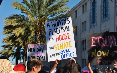 Sign that reads: A woman place is in the house, the senate, and the Oval Office.