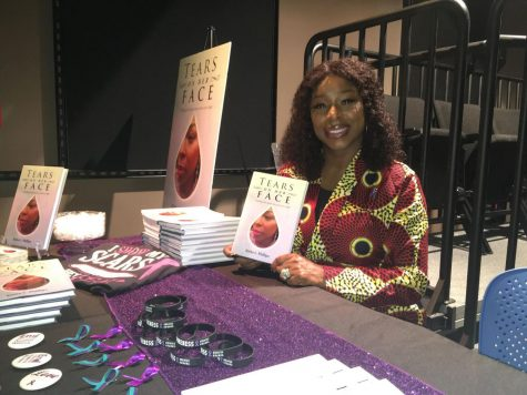 Kisha Phillips smiling at the camera while selling her books.