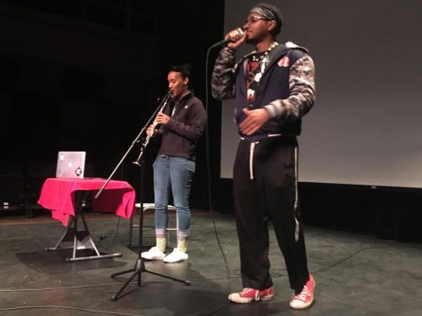 Candyce Raiford and and D'Marcus Andrus both standing and performing at City College.