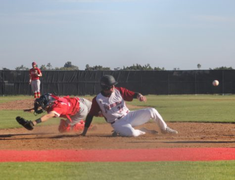 Knights baseball player Chris Barkley scores a run against College of the Desert as the catcher tries to tag him.