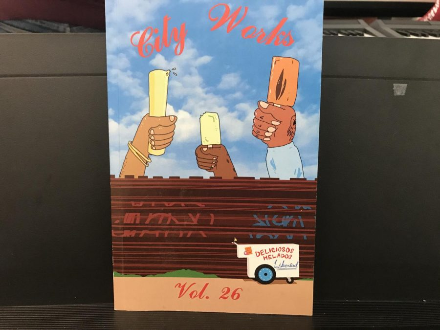 Front cover of City Works, Volume 26 shows three hands sharing an ice-cream behind a rusty wall.