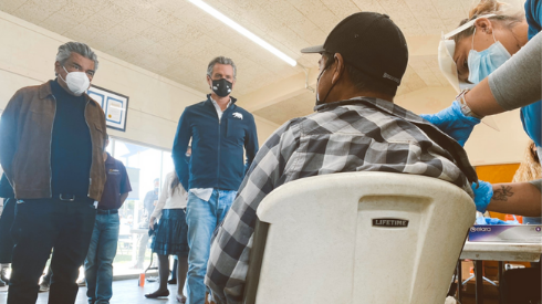 Gavin Newsom (center) and George Lopez (left) visit a Central Valley vaccination station. @GavinNewsom on Twitter