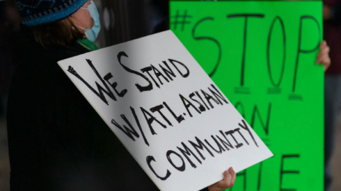 A unidentified person hold a sign in support of the AAPI community. GoFundMe photo