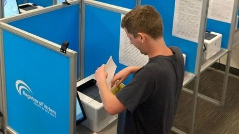 Voter casts their ballot