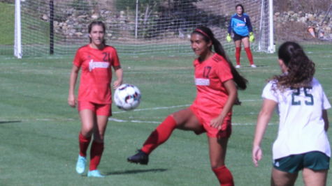 City womens soccer team playing on the field against Grossmont