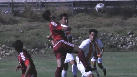 Knight soccer team battles for a ball