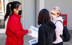 Prospective students speak to a City College outreach representative.